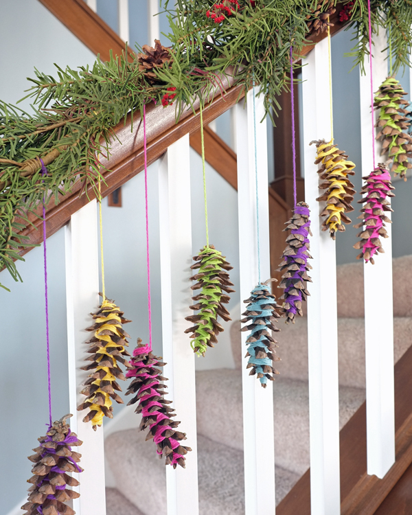 yarn-wrapped-pinecone-garland-on-banister